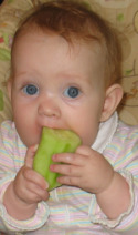 Baby eating cucumber