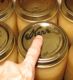 Canning applesauce checking lid for a seal