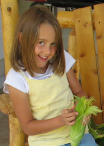 Child Shucking Corn Cobs