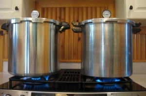 Two pressure canners on the stove