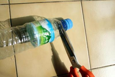 Cut up a disposable water bottle and keep the neck and top,