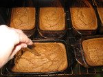 Checking pumpkin bread out of the oven