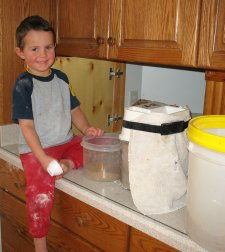 Food Storage Child Helping Grind Flour