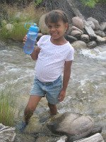 methods of water purification - standing in river with clean drinking water