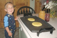 Child Cooking Pancakes